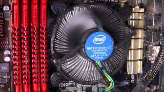 Two spinning fans inside a computer case - closeup