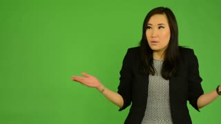 young attractive asian woman do not understand - green screen studio