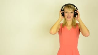 young attractive woman listens horrible music with headphones - horrible music