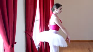 young ballerina dancing in the hall - hall - red curtain