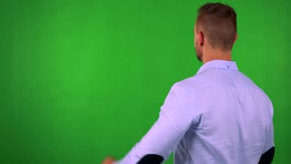 young business man rejoices - shot on back (man looks to screen) - green screen