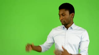 young handsome black man introduce - green screen - studio
