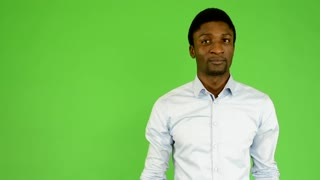 young handsome black man invites - green screen - studio