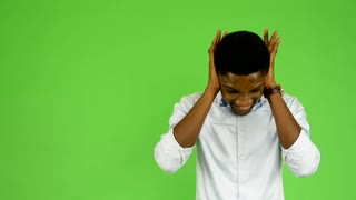 young handsome black man is afraid - green screen - studio