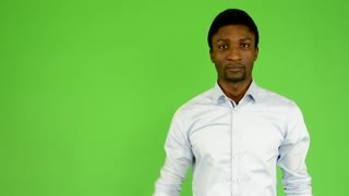young handsome black man protests - green screen - studio