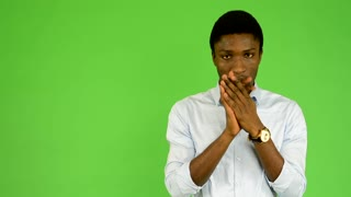 young handsome black man shivers - cold - green screen - studio