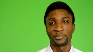 young handsome black man talk - green screen - studio - closeup