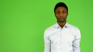 young handsome black man talk - green screen - studio