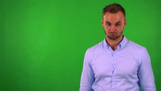 young handsome business man  agrees (shakes with head) - green screen - studio