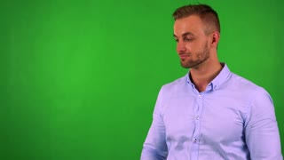 young handsome business man introduces something - green screen - studio