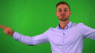 young handsome business man rejoices - green screen - studio
