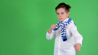 young handsome child boy doing fighting grimaces - green screen - studio