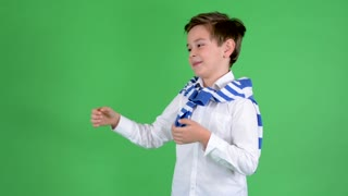 young handsome child boy introduces (with hands) - green screen - studio