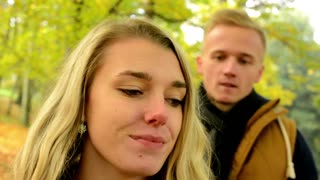 young model couple in love - autumn park(nature) - man gives a gift to woman