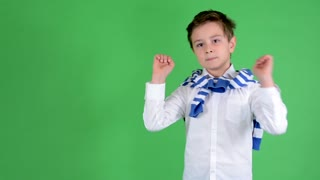 young handsome child boy shows thumbs on agreement - green screen - studio