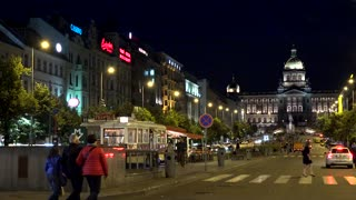 night Wenceslas Square with people and passing cars - buildings and lights