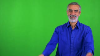 old senior man welcomes - green screen - studio