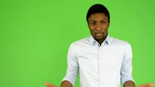 young handsome black man do not understand - green screen - studio