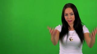 young pretty woman invites - green screen - studio
