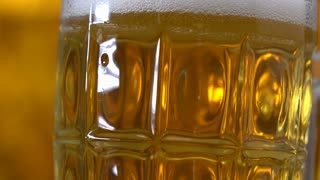 beer glass with air floating bubbles , gold background.