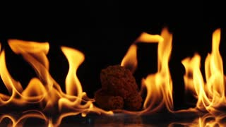 chicken fast food on fire slow motion background.