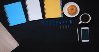 top view stop motion work table on black background