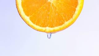 water dropping on an orange fruit.