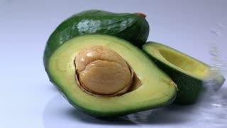 water splashing on an avocado in slow motion.