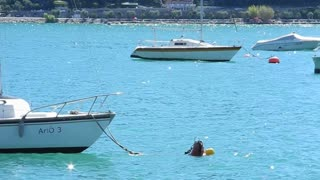 GARDA, ITALY - AUGUST 2012: Boats moored in the blue lake on a sunny day