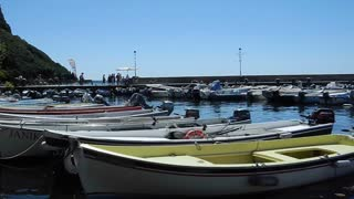GARDA, ITALY - AUGUST 2012: Boats moored in the harbour on a sunny day