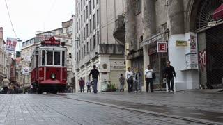 ISTANBUL, TURKEY - SEPTEMBER, 2009: A tram travels from Taksim square  along the touristic Istiklal shopping street