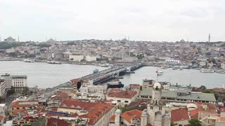 ISTANBUL, TURKEY - SEPTEMBER, 2009: Galata bridge crosses the Bosphorus river at the Golden Horn, with boats and mosques visible in the distance