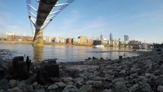 LONDON - JANUARY 2015 Panning time lapse clip showing Millenium Bridge and the River Thames