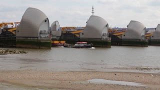 LONDON, UK - APRIL 01, 2016: Cargo boat passes through the Thames Flood Barrier