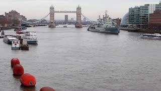 LONDON, UK - APRIL 01, 2016: Tourist boat heads towards Tower Bridge