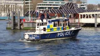 LONDON, UK - APRIL, 2011: Police boat floats on Thames