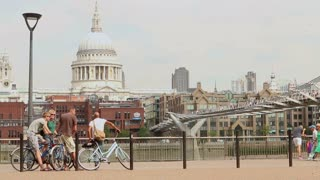 LONDON, UK - AUGUST 8, 2013: Cyclists gather on the Southbank with St Pauls Cathedral and Millennium bridge in the background