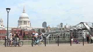 LONDON, UK - AUGUST 8, 2013: Cyclists set off along the Southbank with St Pauls Cathedral in the background