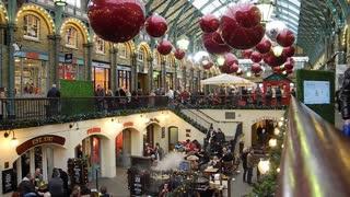 LONDON, UK - DECEMBER 19, 2012: Christmas shoppers in Covent Garden