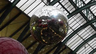 LONDON, UK - DECEMBER 19, 2012: Mid-shot of rotating Christmas glitterball in Covent Garden Market