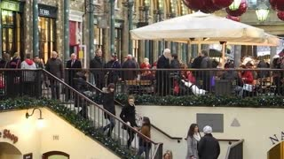 LONDON, UK - DECEMBER 19, 2012: Shoppers enjoy the Christmas decorations in Covent Garden market