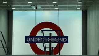 LONDON, UK - DECEMBER 3, 2014: Travellers exit the London Underground