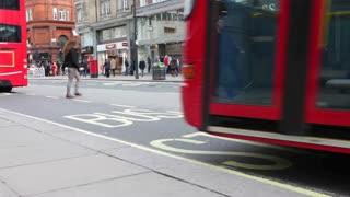 LONDON, UK - FEB, 2012: London bus arrives and drops off passengers