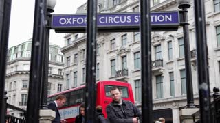 LONDON, UK - FEB, 2012: Pedestrians enter Oxford Street Tube Station