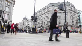 LONDON, UK - FEB, 2012: Shoppers in Oxford Circus, with buses in background