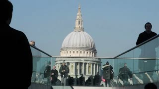 LONDON, UK - FEBRUARY 19, 2013: Commuters and tourists cross Westminster Bridge over the river Thames