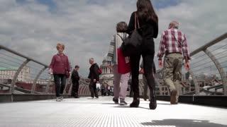 LONDON, UK - JUNE 15, 2016: Commuters and tourists on Millenium Bridge