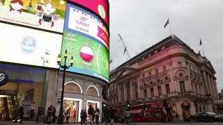 LONDON, UK - JUNE 28: Buses and Taxis pass the illuminated adverts at Piccadilly Circus