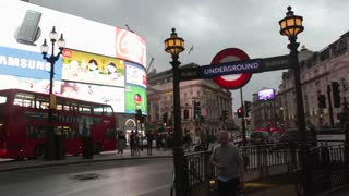 LONDON, UK - JUNE 28: Cars, people and buses in the evening at Picadilly Circus