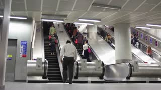 LONDON, UK - JUNE 28: Passengers exit Kings Cross London Underground  Staion via escalators